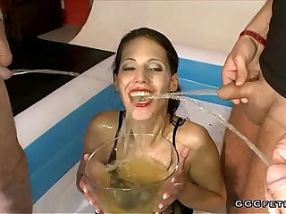 Brunette drinking and swallowing urinei