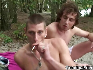 Flabby granny gets double dicked near the lake