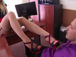 Extremely horny secretary in stockings gives perfect footjob
