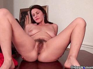 Mature mom finger fucks her hairy wet pussy