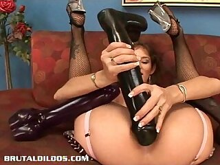 Busty babe Felony fills her pussy stuffed with a monster dildo