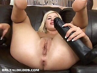Busty blonde gapes tight ass with brutal dildo