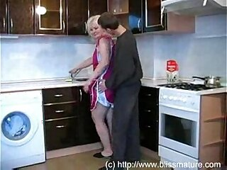 Russian Mom With Son In Kitchen Free