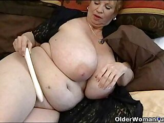 Fat granny with her big tits plays with vibrator