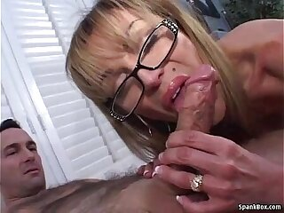 Mature gives blowjob and smokes a cigarette